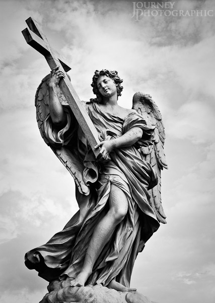 Black and white picture of the angel with a cross on the Ponte Sant'Angelo, Rome