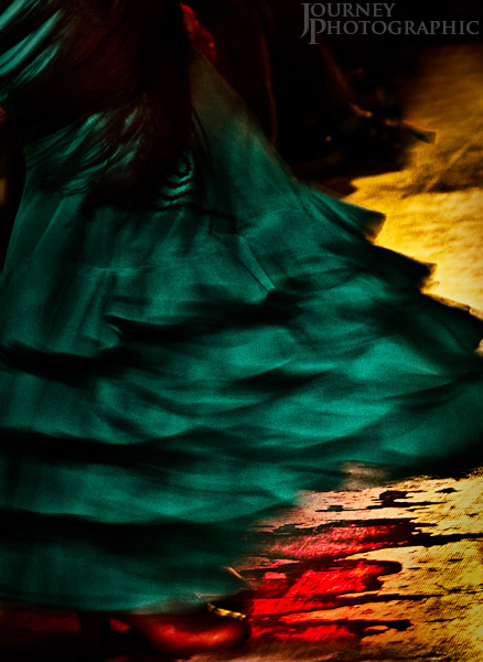 Colour picture of a flamenco dancer with green skirt and red shoes, Granada, Spain