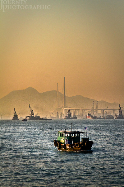 Picture of boat and floating cranes, Victoria Harbour, Hong Kong
