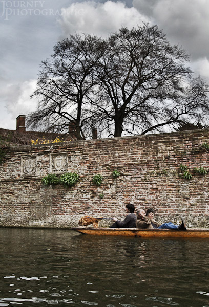 Picture of couple, lady and dog punting in Cambridge, England
