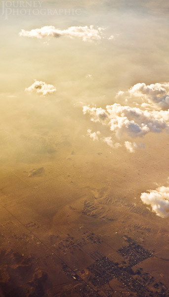 Picture from 30,000ft looking down through clouds to town below, USA