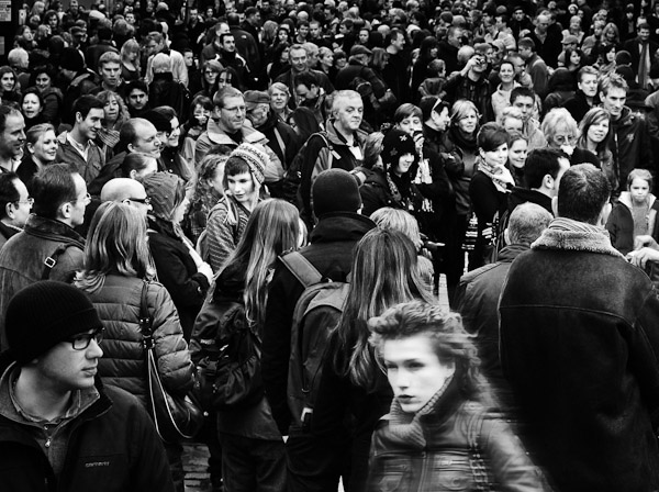 Black and white picture of a face in a crowd, Covent Garden, London