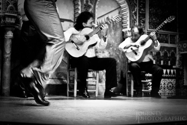 Black and white picture of flamenco dancer feet and guitar players, Madrid, Spain