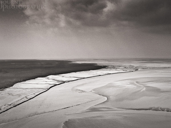 Black and white picture of mud flats, Mont St Michel, Normandy, France