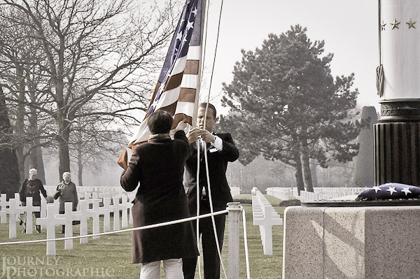 Picture of flag lowering ceremony, American Cemetery, Normandy, France