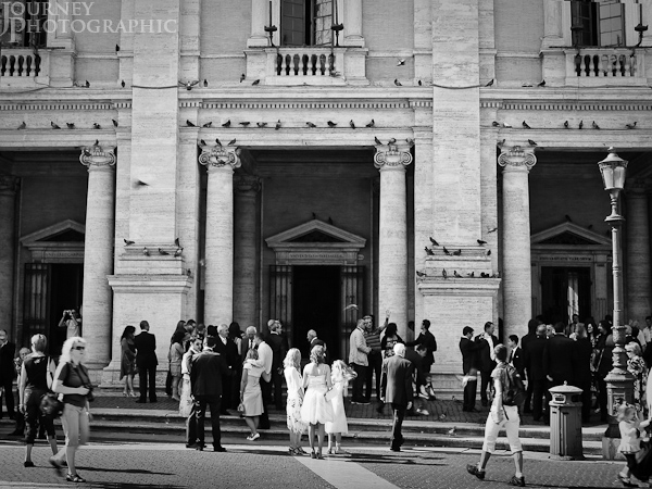 Black and white picture of wedding party and tourists, Piazza_del_Campidoglio, Rome