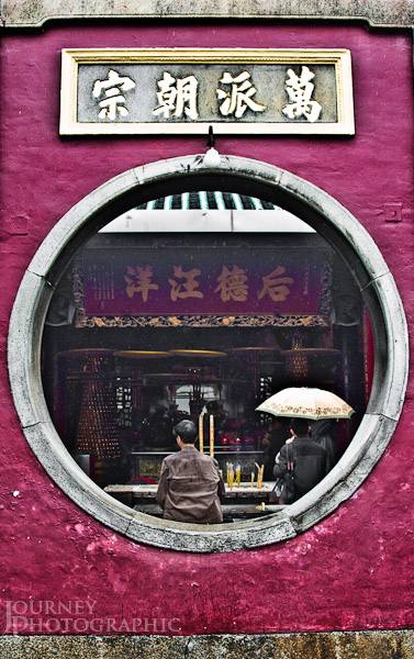 Picture of worshippers burning incense at a temple in Macau