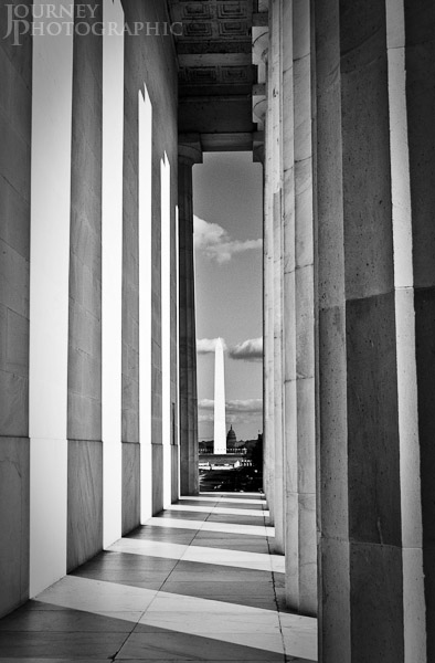 Black and white picture of the Washington Monument through the columns of the Lincoln Memorial, Washington D.C.