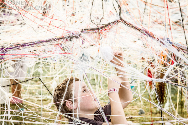 Picture of boy contributing to the National Folk Festival Yarn Labyrinth, Canberra, Australia