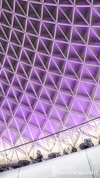 Picture of people and roof of Kings Cross Station, London