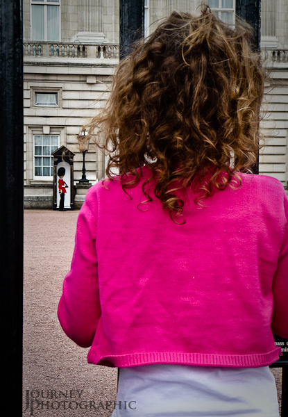 Picture of little girl watching the guards at Buckingham Palace, London