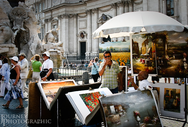 Picture of a smoking man selling art in Piazza Navona, Rome, Italy
