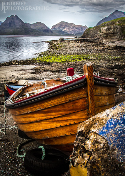 Picture of wooden boat and the Black Cuillin from Elgol, Skye