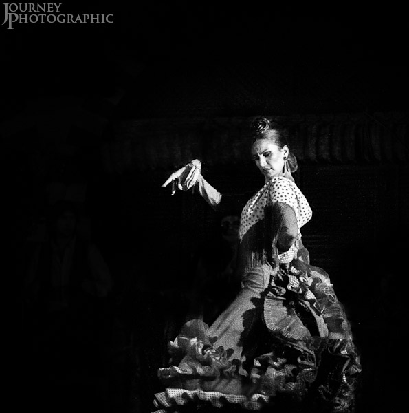 Black and white picture of a flamenco dancer in ruffled dress, Seville, Spain