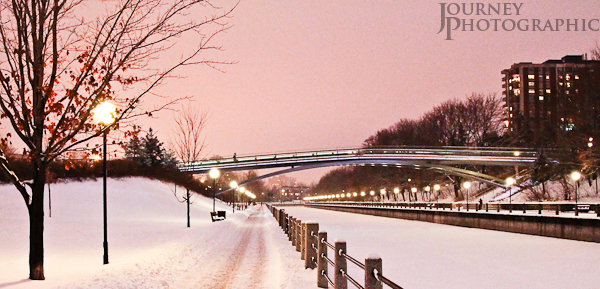 Picture of the Rideau Canal in snow with pink sky, Ottawa, Canada