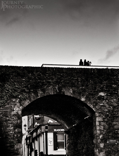 Black and white picture of group posing on Castle Gate, Derry, Northern Ireland