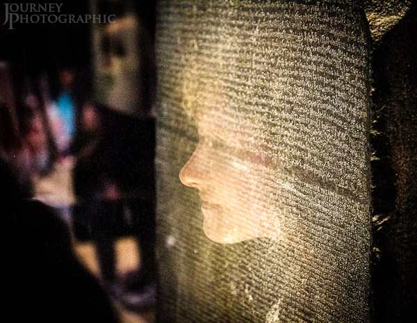 Picture of reflection of woman looking at the Rosetta Stone, British Museum, London