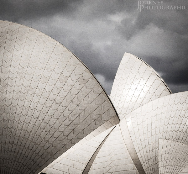 Black and white picture of the sails and fans of the roof of the Sydney Opera House, Australia