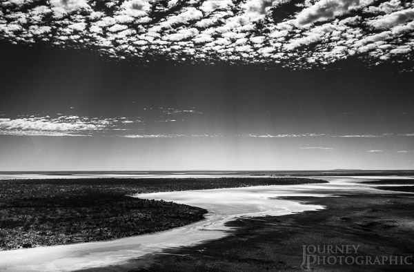 Black and white picture of salt river leading into Lake Amadeus, Northern Territory