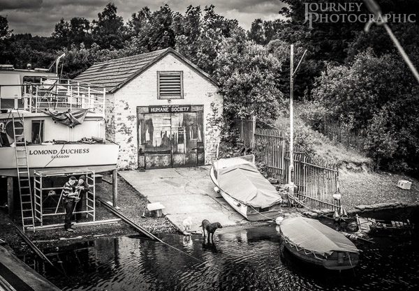 Black and white picture of boat and humane society building, Loch Lomond