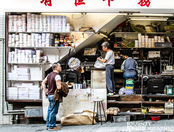 Street picture of people doing business in alley shop, Central, Hong Kong