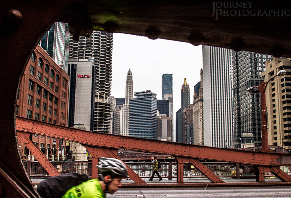 Picture of skyscrapers, cyclist and pedestrian, La Salle Street Bridge, Chicago