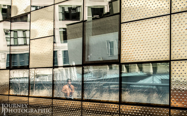 Picture of man in reflective metal wall, High Line Park, New York City, USA