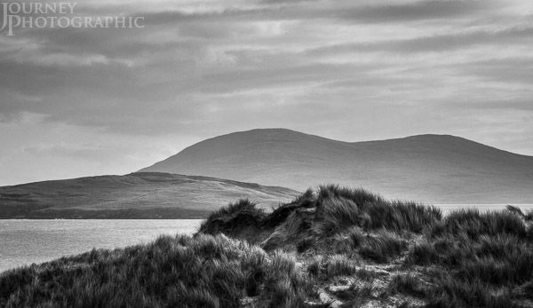 Black and white picture of dunes, grass and mountains, Luskentyre beach, Isle of Harris, Scotland