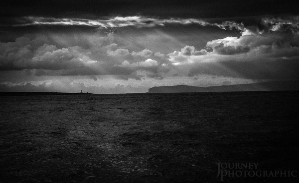 Black and white picture of pentland firth and lighthouse, Orkney Islands, Scotland