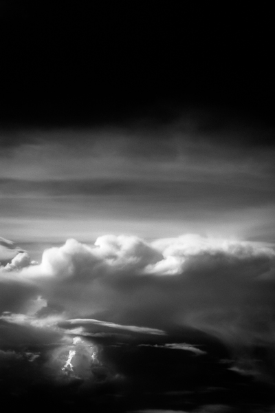 Black and white aerial landscape picture of clouds and river, USA