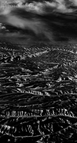 Black and white aerial landscape picture of ridges and canyons, USA